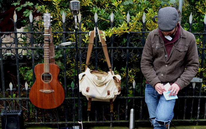 busker helping others through music